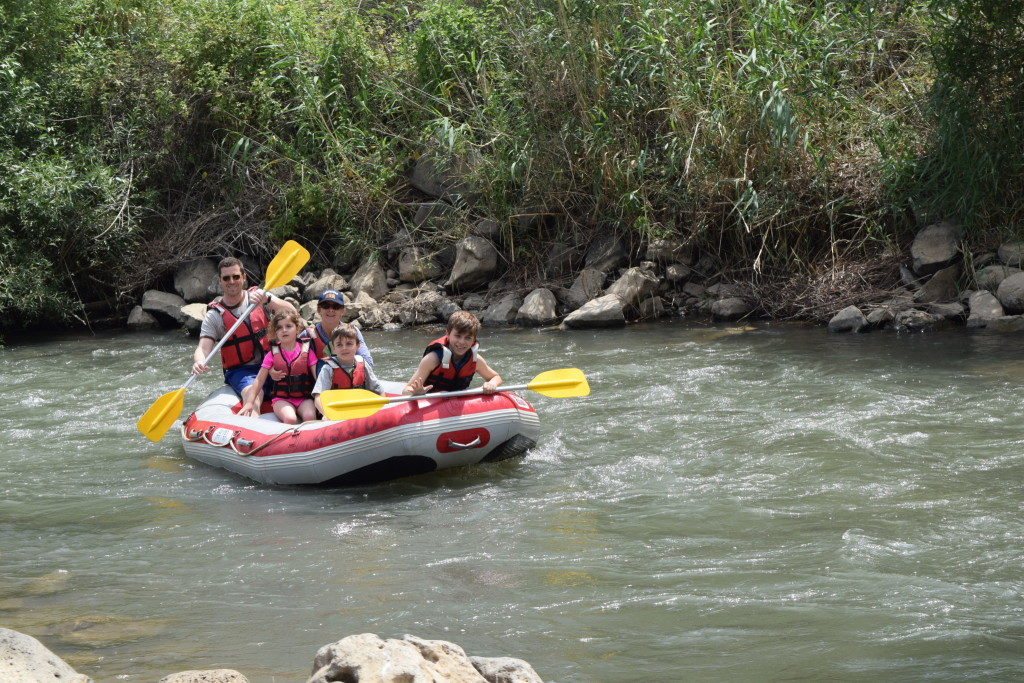 A family prepares to run a rapid on the Jordan river. There are several points on the river where one can float on a raft down the river.