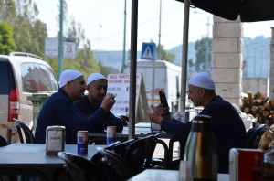 Young White-capped Druze men enjoying a break at a road-side restaurant in the Druze village of Masade.
